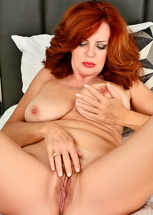 Curvy Redhead MILF Andi James and her huge tits