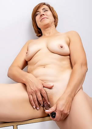 Brown haired milf Eleanor loves playing dildo sex toy