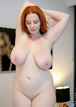 Naked Avalon squeezes her own big boobs